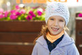 Funny little girl in jacket and hat Royalty Free Stock Photography
