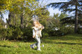 Funny little girl with soap bubbles in park Royalty Free Stock Images