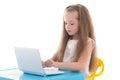Funny little girl using laptop isolated on white background Stock Image