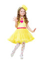 Funny little girl wearing nice yellow dress isolated on white Royalty Free Stock Photo