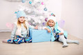 Funny little girls posing beside a decorated Christmas tree Royalty Free Stock Photo
