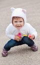 Funny little happy girl playing outdoors with soap bubbles Royalty Free Stock Photo