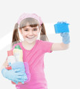 Funny little housewife cleaning window Royalty Free Stock Photo