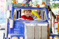 Funny little kid boy riding on a merry-go-round carousel Royalty Free Stock Photo