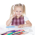 Funny little schoolgirl portrait of a y happy at the desk over white Stock Image