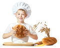 Funny little scullion is kneading dough Stock Images