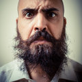 Funny long beard and mustache man with white shirt on gray background Royalty Free Stock Photos
