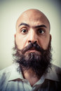 Funny long beard and mustache man with white shirt on gray background Stock Photos