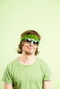 Funny looking young man wearing headband and sunglasses Stock Photos