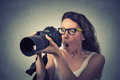 Funny looking young woman with digital camera Royalty Free Stock Photo