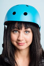 Funny looking young woman wearing cycling helmet Royalty Free Stock Photo