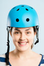 Funny looking young woman wearing cycling helmet Stock Photo