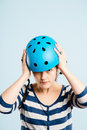 Funny looking young woman wearing cycling helmet Stock Images