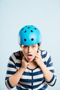 Funny looking young woman wearing cycling helmet Stock Image