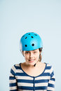 Funny looking young woman wearing cycling helmet Royalty Free Stock Image