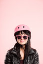 Funny looking young woman wearing cycling helmet glasses Stock Photos