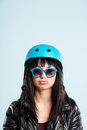 Funny looking young woman wearing cycling helmet glasses Royalty Free Stock Photo