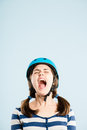 Funny looking young woman wearing cycling helmet screaming Royalty Free Stock Image