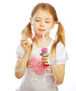Funny lovely little girl blowing soap bubbles portrait of Stock Photography