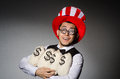 Funny man with american hat and sacks of money Royalty Free Stock Image