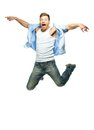 Funny man in blue shirt and jeans jumping Stock Images