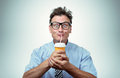 Funny man drinking from a paper cup with a straw Royalty Free Stock Photo