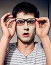 Funny man with facial mask and glasses Royalty Free Stock Photos