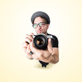 Funny man with a funny surprise expression shooting with his vintage reflex photo camera Royalty Free Stock Photo