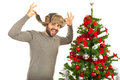 Funny man with fur hat near xmas tree wearing and standng isolated on white background Stock Image