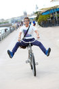 Funny man having fun riding bicycle in town Royalty Free Stock Photo