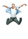 Funny man jumping in blue shirt and jeans Stock Photography