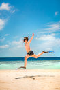 Funny man jumping in flippers and mask holiday vacation on a tropical beach at maldives islands Royalty Free Stock Photo