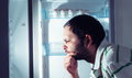 Funny man  looking into refrigerator Royalty Free Stock Photo