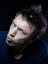 Funny man portrait pucker strain studio on black background of a expressive caucasian Stock Photography