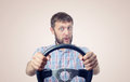 Funny man with a steering wheel, car drive concept Royalty Free Stock Photo