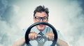 Funny man with a steering wheel in smoke Royalty Free Stock Photo