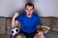Funny man watching football on tv Royalty Free Stock Photography