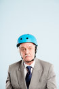 Funny man wearing cycling helmet looking tired Stock Photos