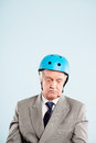 Funny man wearing cycling resting helmet Royalty Free Stock Photography
