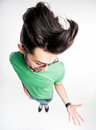 Funny man with wierd hairstyle showing his palm wide angle shot Royalty Free Stock Photography