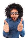 Funny man with the wig showing thumbs up sign Royalty Free Stock Photo