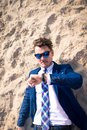 Funny manager lost in time but stays calm. Serious young man in elegant suit Royalty Free Stock Photo