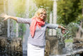 Funny Mature Middle Aged Smiling Blond Woman Wearing Spectacles Posing Outdoors in Park. Royalty Free Stock Photo