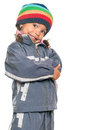Funny mixed race little girl isolated on white wearing a colorful beanie hat and a jacket with an attitude Stock Photo