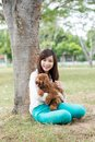 Funny mood portrait of a girl with a dog in park Stock Image