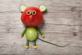 Funny mouse made of red and green tomato Royalty Free Stock Photo
