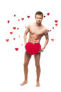 Funny naked man holding big red paper heart young cheerful caucasian isolated on white background with falling hearts Stock Photography