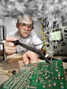 Funny nerd scientist soldering at laboratory Royalty Free Stock Photo