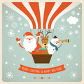 Funny new years company in hot air ballon santa deer and snowman Stock Photos