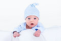 Funny newborn baby boy playing on his tummy little Stock Photo